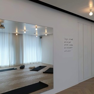 Intoku Yoga & Ayurveda - Practice room with mirror
